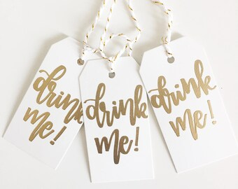 Hand Lettered Wine Tags | Drink Me Tags | Gold and White Embossed Tags | Drink Tags | Drink Me! | Sip Sip Hooray! |