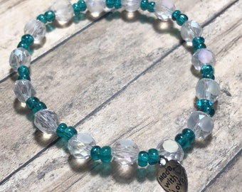 Clear and blue beaded bracelet. Womens bracelet. Beaded bracelet. Teal bracelet. Elastic bracelet.