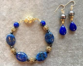 Gold and lapis bracelet earring set