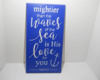 """Hand made wood wall plaque. """"mighter than the waves of the sea is his love for you""""."""