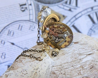 Steampunk locket vintage charms and gears with moving watch hands ornate chaine and pearl design.