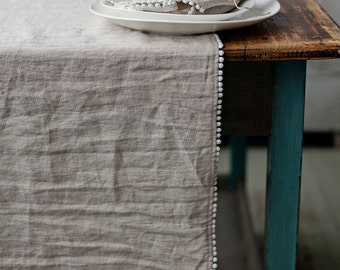 Softened linen table runner with pom poms in 12 colours