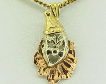1960's 14 K yellow, white and pink gold clown pendant.