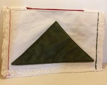 beige triangle designed clutchbag