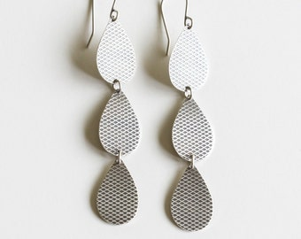 "Dangly silver earrings of 3 textured teardrop shapes in a linear line, simple and chic design for everyday wear - ""Lena Earrings - Silver"""