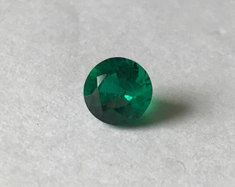 6.0 mm round emerald - 0.84 ct