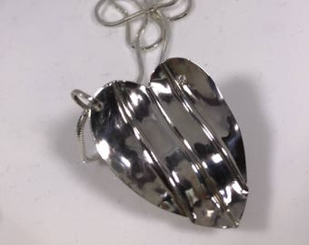 Ripples of love heart pendant