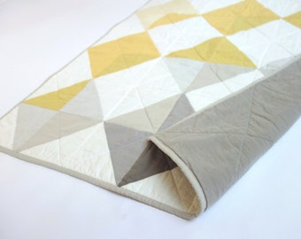 Nine diamonds baby quilt in grey + gold. Cute baby shower gift.