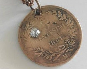 Necklace with antique coin and rhinestones