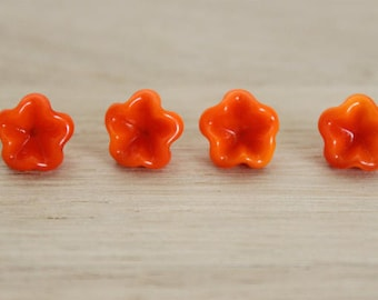 a flower, lampwork headpins, copper, orange