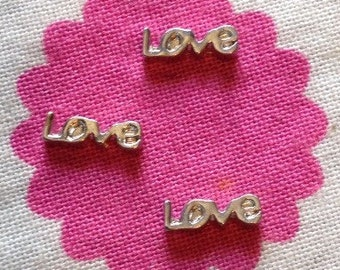 Silver LOVE floating locket charm.