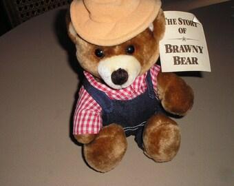 Brawny teddy bear in denim overalls