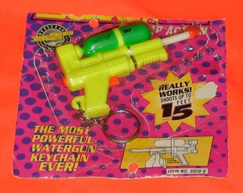 Vintage 90's Official  Super Soaker 50 Mini Key chain! Unopened! Basic Fun!