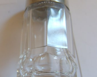Antique glass sugar shaker with silver plated top