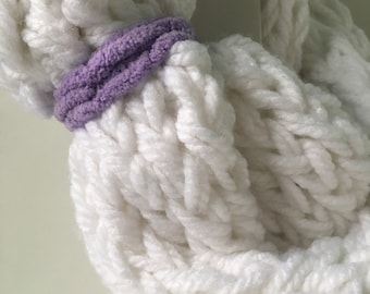 White infinity scarf finger knitted with colored strap.