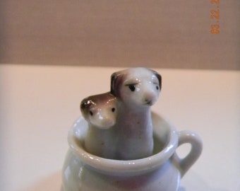 Vintage pair of puppy dogs in a chamber pot potty figurine..Japan..adorable