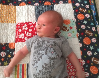 Sport themed baby quilt or throw with football basketball baseball in multi color