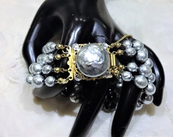 Beautiful Vintage Miriam Haskell Faceted Black Glass Bead and Light Grey Baroque Pearl Four Strand  Fancy  Clasp Bracelet