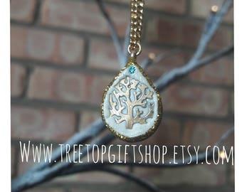 Golden treetop pendant