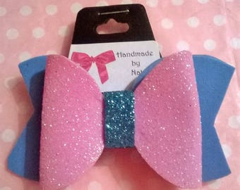 Blue and glitter pink bow hair clip.