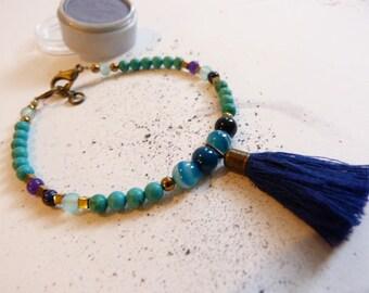 Stone, turquoise and lapis lazuli tassel bracelet.
