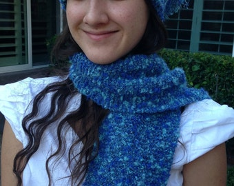 Blue knitted scarf and crocheted hat.