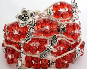 Handmade Four Wrap Hemp Wrap Bracelet with 6mm Red Rounds, Clear Seed Beads, and Silver Butterfly Accents
