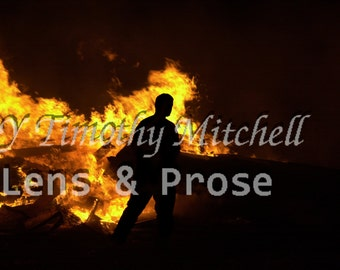 Man Silhouette in fire by Timothy Mitchell