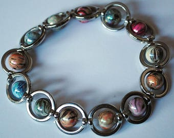 Planets with rings bracelet