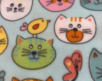 RaToob, Pretty Kitties in Green Orange White Yellow Blue and Pink with Butterflies and Birdies on Light Blue