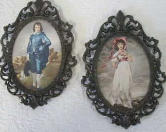 Vintage metal framed girl and boy prints with glass front metal frame is marked from Italy
