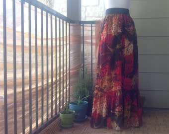 red floral maxi skirt ; one of a kind ; red orange and yellow flower patterned floor length skirt with black elastic waistband