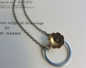 Horseshoe and Blossom charm necklace - gunmetal stainless steel with golden brass flower - modern jewellery