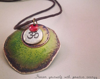 Yoga necklace OM charm enameled with warm green