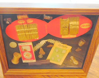 Hand decorated shadow box, filled with vintage sewing notions.  Wall decor, sewing room decor. Very good condition.
