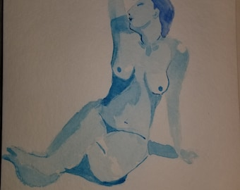 Female figure study on blue.