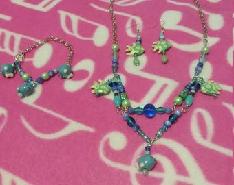 Custom-made blue beaded fish charm necklace set with earrings and bracelet!