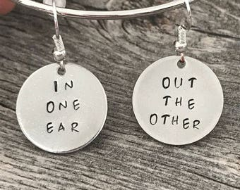 Funny earrings - in one ear and out the other
