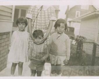 Vintage photo 1920 hidden mother Holds Face Child in Her Hands Big Eyes