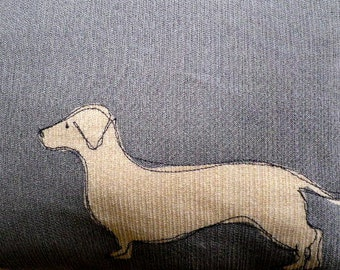 Hand printed muted blue sausage dog cushion