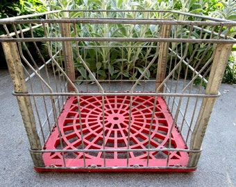 Vintage Industrial Dairy Crate With Red Base