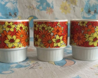 Vintage retro orange and yellow flower cup - 1970's stackable glasses