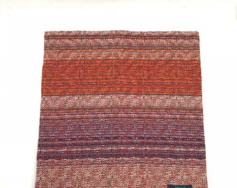 Handwoven cowl with British Blue Faced Leicester wool and organic cotton in rouge, brown, blue and neutrals. Warm winter scarf, snood.