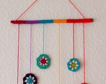 Mobile multicolored flowers, wood and crochet