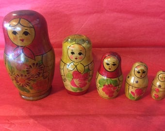 Nesting dolls with red scarf and flowers