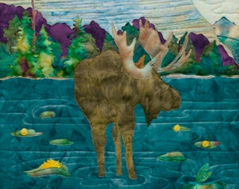 """McKenna Ryan pattern """"Knee Deep"""" with moose in a river."""