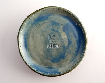 small plate/saucer with sigh and rooster stamps