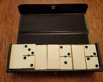Vintage White Dominoes in a Black Case