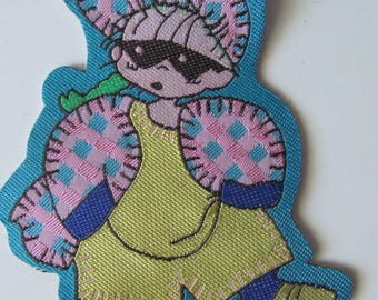 Decorative sewing pattern representing a girl with mask