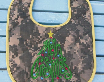 ACU ARMY Christmas Baby Bib with Merry Christmas embroidery in the shape of a tree trimmed with yellow around the edges